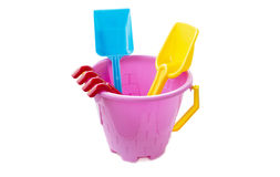 Toy plastic bucket with a shovel and a rake Stock Photo