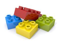 Toy Plastic Building Blocks. A pile of four toy plastic building blocks with raised round connectors. Similar to legos Royalty Free Stock Image