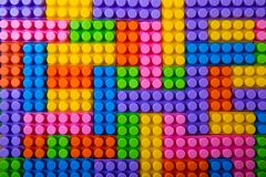 Toy plastic building blocks background. Top view stock photo