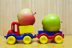 Toy plastic car with apple Stock Photography
