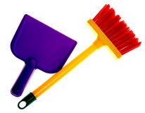 Toy plastic dustpan and broom. Isolated on a white background Royalty Free Stock Image