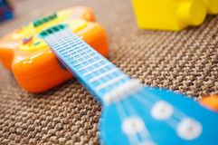 Toy plastic guitar Stock Images