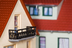 Toy plastic house with an extension and balcony Royalty Free Stock Photos