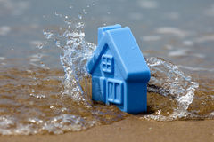 Toy plastic house on the sand Royalty Free Stock Photos