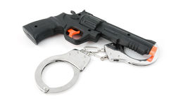 Toy play gun with handcuffs. Isolated on white background Stock Photos