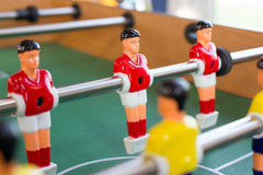 Toy players. foosball. soccer ball Stock Photo
