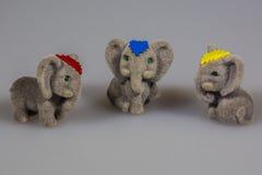 Toy plush elephants. Three lovely toy plush elephants Royalty Free Stock Photo