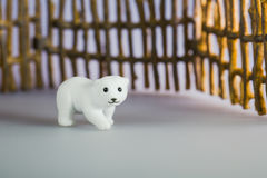 Toy polar bear in front of fence Royalty Free Stock Photography
