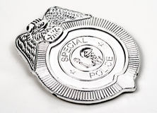 Toy police badge. Childrens toy special police badge silver royalty free stock image