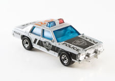 Toy police car. A police toy car on white background Stock Images