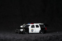 Toy police car. A toy police SUV in black background Royalty Free Stock Photography