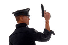 Toy police officer with gun. Plastic toy police officer with gun in hand isolated over white Stock Image