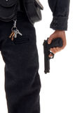 Toy police officer with gun. Plastic toy police officer with gun in hand isolated over white Royalty Free Stock Photo
