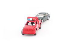 Toy police truck pulling car Royalty Free Stock Photos