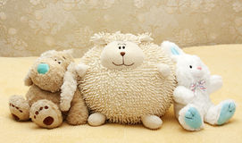 Toy puppy, leveret and doll Stock Images