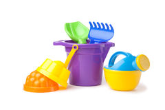 Toy purple bucket with spade and rake, watering-can Stock Image