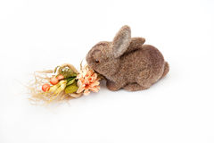 Toy rabbit. With a flowers on a white background Stock Photo