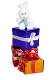 Toy rabbit, and Christmas gifts on white Royalty Free Stock Image