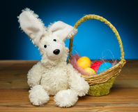 Toy rabbit with Easter eggs Royalty Free Stock Images