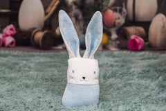 Toy rabbit on a fluffy patch on Easter backround. Children `s toys look great like easter decoration and give a fun atmosphere in the house stock image