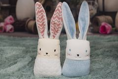 Toy rabbit on a fluffy patch on Easter backround. Children `s toys look great like easter decoration and give a fun atmosphere in the house royalty free stock images
