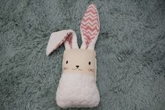 Toy rabbit on a fluffy patch on Easter backround. Children `s toys look great like easter decoration and give a fun atmosphere in the house royalty free stock photos