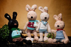 Toy Rabbit Gathering. Four toy rabbit with brown color background Stock Photos