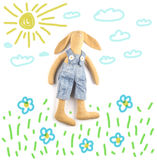 Toy rabbit with handmade. Figure grass, flowers, sky, sun, rabbi Royalty Free Stock Images
