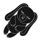 Toy rabbit icon in black style isolated on white background. Sleep and rest symbol stock vector illustration. Stock Photos