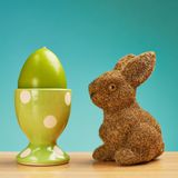 Toy rabbit next to an egg holder Royalty Free Stock Images