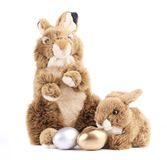 Toy rabbits with easter eggs. Royalty Free Stock Images