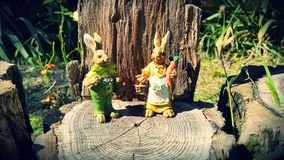 Toy rabbits in the garden Stock Images