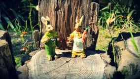 Toy rabbits in the garden. As a garden decor stock images