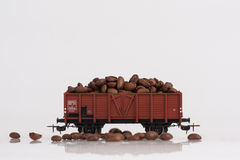 Toy rail car with coffee beans. Pictured items of a toy railroad Stock Photos