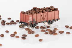 Toy rail car with coffee beans three. Pictured items of a toy railroad Stock Images