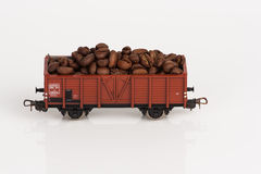 Toy rail car with coffee beans two. Pictured items of a toy railroad Royalty Free Stock Photos