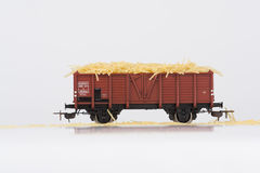 Toy rail car with pasta. Pictured items of a toy railroad Stock Photography