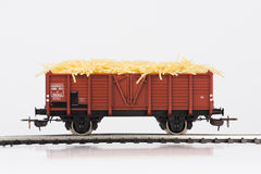 Toy rail car with pasta three. Pictured items of a toy railroad Royalty Free Stock Image