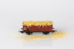 Toy rail car with pasta two. Pictured items of a toy railroad Royalty Free Stock Photo