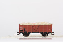 Toy rail car with rice. Pictured items of a toy railroad Royalty Free Stock Image