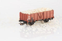 Toy rail car with rice two. Pictured items of a toy railroad Royalty Free Stock Photography