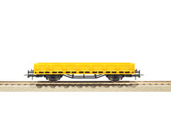 Toy railroad carriage. Yellow cargo carriage railroad toy model, H0 scale, isolated on white with clipping path Stock Image