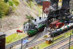 Toy railroad locomotive with smoke Royalty Free Stock Images