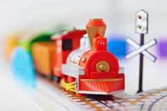 Toy railway - red engine closeup Stock Images