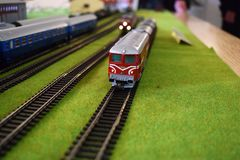 Toy railway station with trains. Railroads, station building. Miniature railstation mock-up that represents a real life railstation stock photos