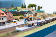 Toy railway with train and station. Toy railway with train and platform station closeup Stock Images