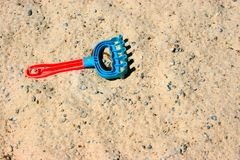 Toy rake and sand Royalty Free Stock Photo