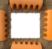Toy rake and sand photo frame royalty free stock photos