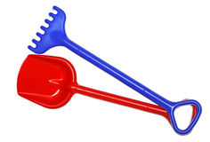 Toy rake and  shovel. Blue plastic toy rake and red plastic toy shovel,  isolated on a white background Stock Images