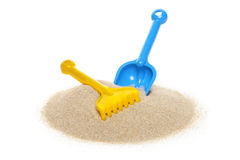Toy rake and spade Royalty Free Stock Images